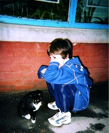 Boy and Cat in an alley in Ukraine